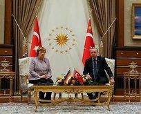 Erdoğan Merkeli o ifadesinden dolayı uyardı
