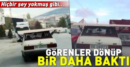 Ankarada araba üzerinde sunta taşıyan sürücü hayrete düşürdü