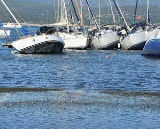 SON DAKİKA HABERİ: İzmir'de korkutan görüntü: Denizin taştığı Seferihisar'da deniz çekildi