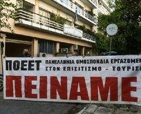 Miçotakis'e açız pankartlı tepki