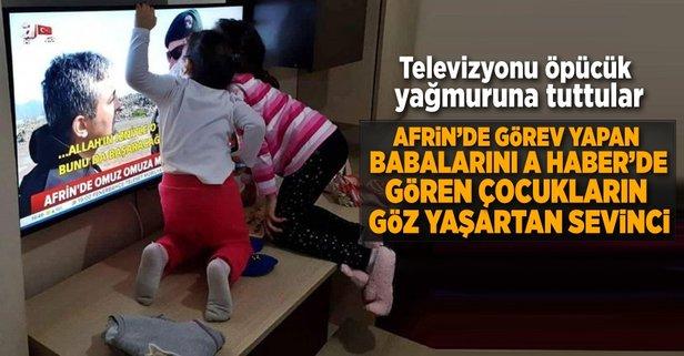 Babalarını televizyonda gören polis çocuklarının sevinci