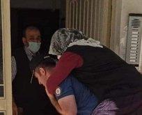 Polis ayağı kırılan kadını sırtında taşıdı