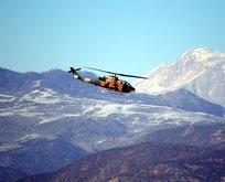 Helikopterler ateş altına aldı