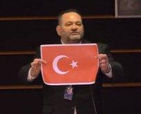 Türk bayrağını yırtan alçak Yunan vekil sabıkalı çıktı!