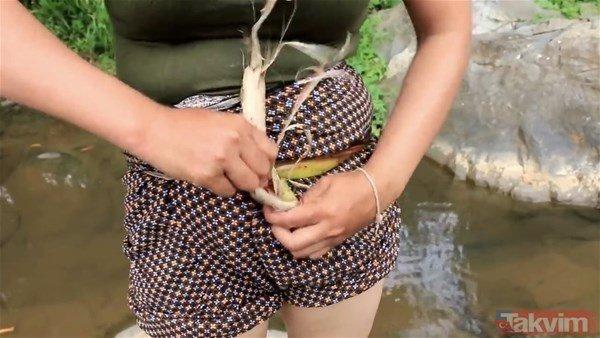 Böyle av görülmedi! Elleriyle yakaladığı balığın içinden...
