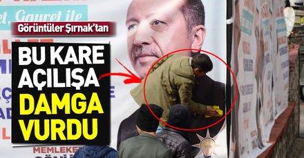 Şırnak'ta duygulandıran görüntü! 15 yaşındaki çocuk, Başkan Erdoğan'ın kirlenen afişini temizledi
