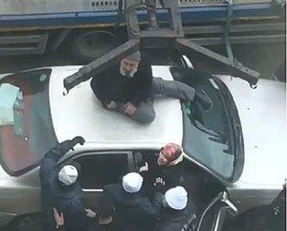 İlginç görüntü! Polislere engel olmak için her yolu denedi