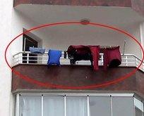 Komşuların dikkatini balkona asılan çamaşırlar çekti!