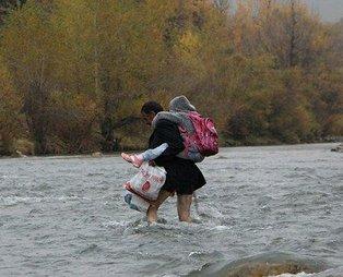 Bingöl'de babalarının sırtında okula gitmek zorunda kalan kardeşler için köprü yapılacak