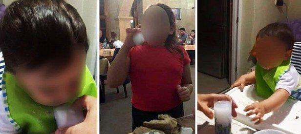 Bursa'da çocuklarına içki içiren anne ve baba Uşak'ta gözaltına alındı